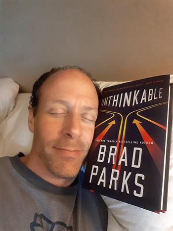 Brad-sleeping-with-book